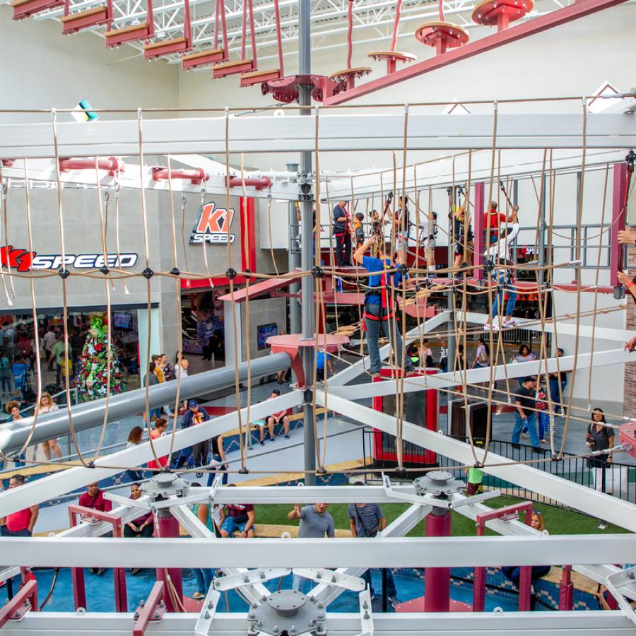 Kids navigate the indoor aerial ropes course at Route 66 Mall.