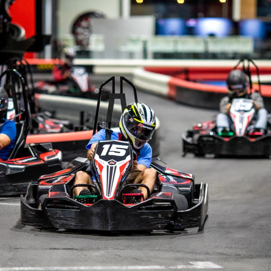 A group races go-karts at Route 66 Mall.