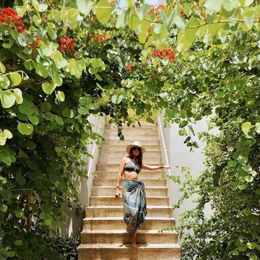 A woman goes down stairs at the Hix Island House in Vieques.