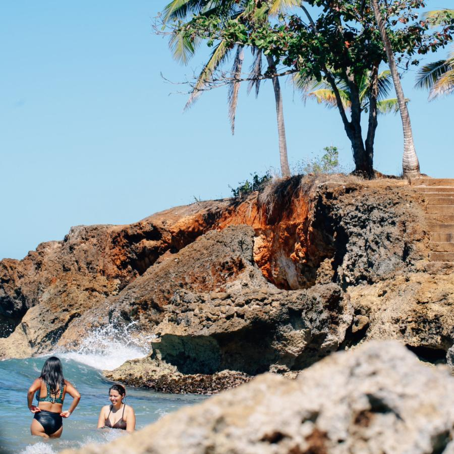 Swimmers at Wishing Well Beach in Aguadilla, Puerto Rico.