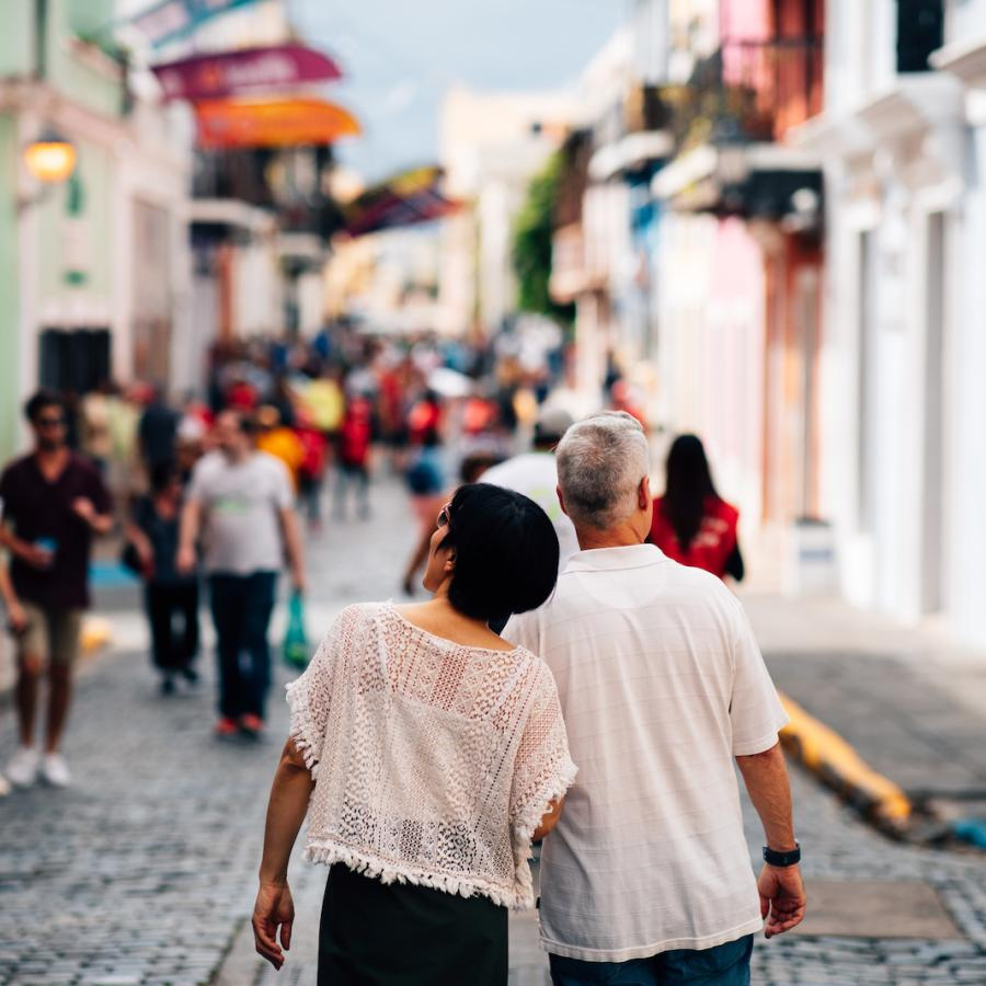 A couple strolls down San Juan's historic cobblestone streets.