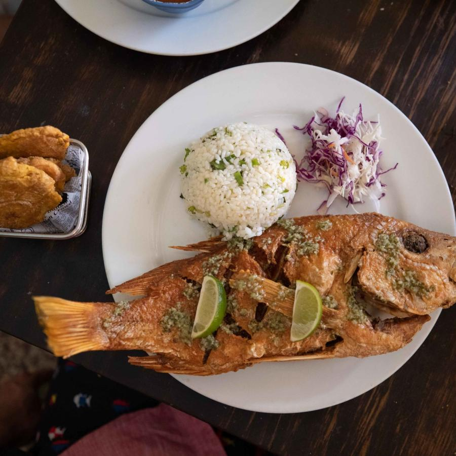 A savory dish with deep fried fish and white rice.