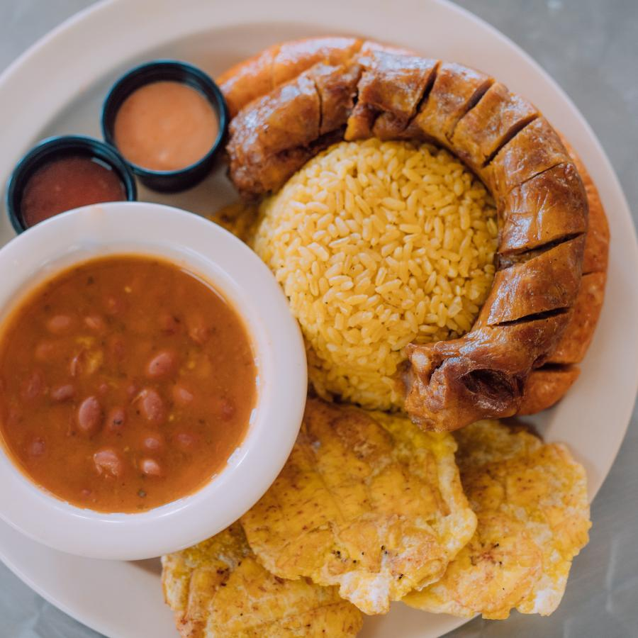 A classic dish of longaniza, rice and beans, and tostones.