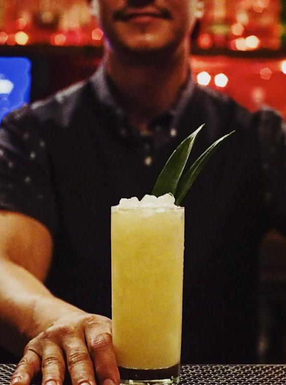 A bartender serves a Pina Colada at Shing-A-Ling, the innermost bar or La Factoría.