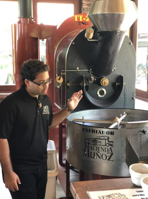 An employee operates coffee production machinery at Hacienda Munoz.