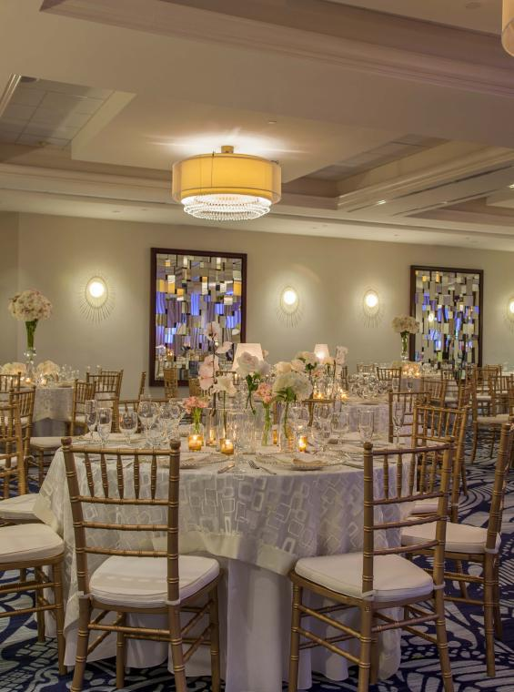 A beautiful wedding reception table setting in an indoor setting.