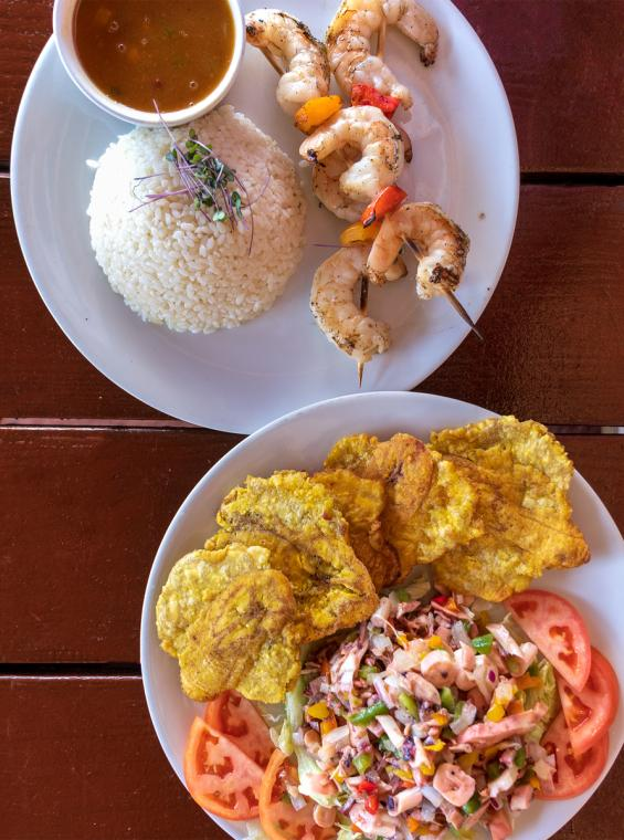 Plates of Puerto Rican food on a table viewed from overhead