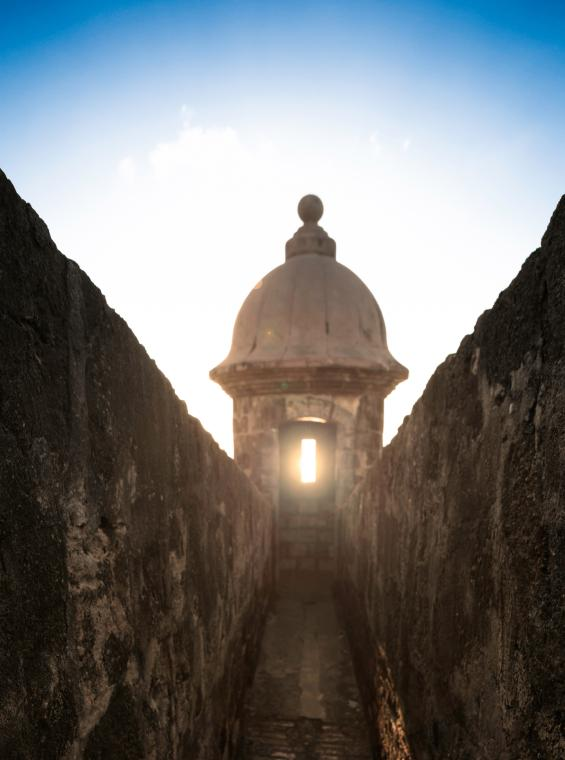 The sunlight shines through the window of a guard tower at El Morro.
